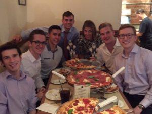 Thin Business Sparty, Helen Dashney, and FMI scholars enjoy pizza.