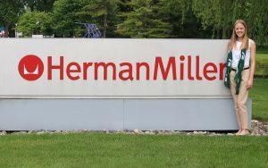 Katlynn Roden poses next to the HermanMiller sign