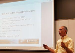 Chris Rizik gives his presentation on New Economy.