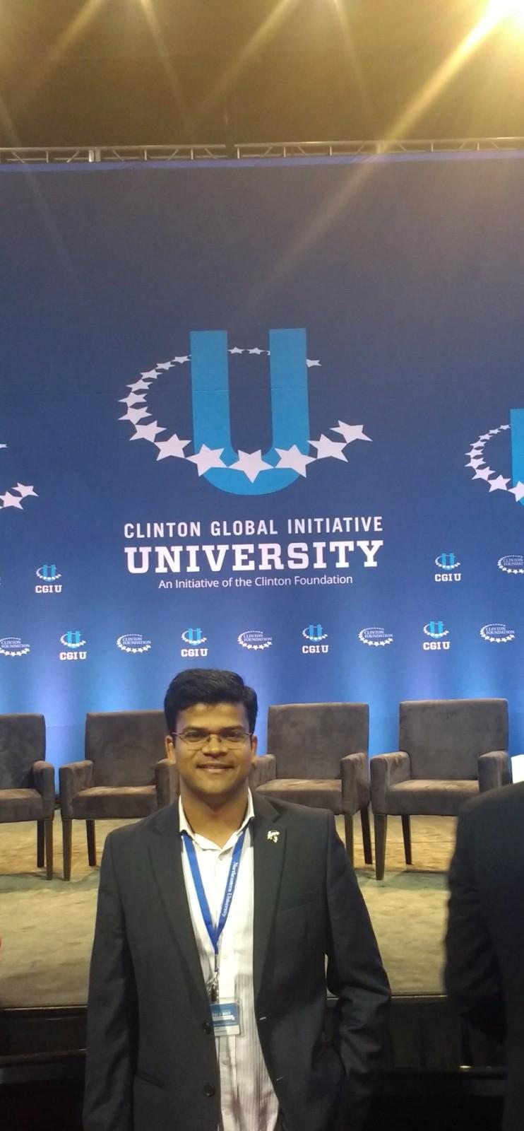Abhishek Jindal in front of a Clinton Global Initiative University backdrop