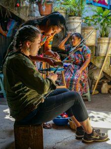 Morgan Burns (BA Accounting '18) learning to weave in Guatemala