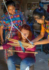 Broad College Professor Paulette Stenzel tries her hand at weaving.
