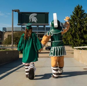 Nicole Niemiec and Sparty wave good-bye to Spartan Stadium. Photo courtesy Nicole Niemiec