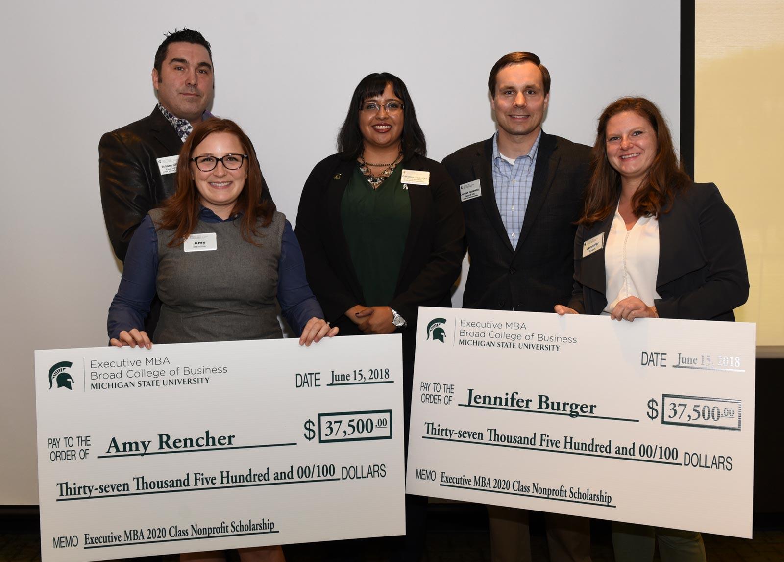 2018 Broad College of Business EMBA non-profit scholarship winners. Alumni Board Directors: Adam Gibbs, Carolina Fuentes, Jordan Hankwitz. Winners: Amy Rencher, Jennifer Burger.