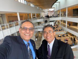 Dean Sanjay Gupta shows UGM Rector/President around the Minskoff Pavilion.