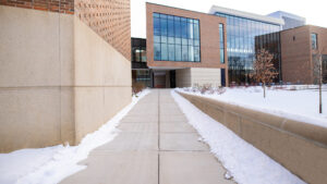 Zoom background set on a sidewalk leading up to the MSU Broad College of Business Edward J. Minskoff Pavilion