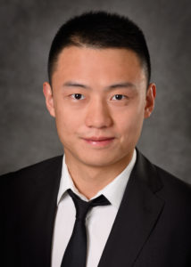 A professional headshot of Yang Fu (M.S. Business Analytics '19)