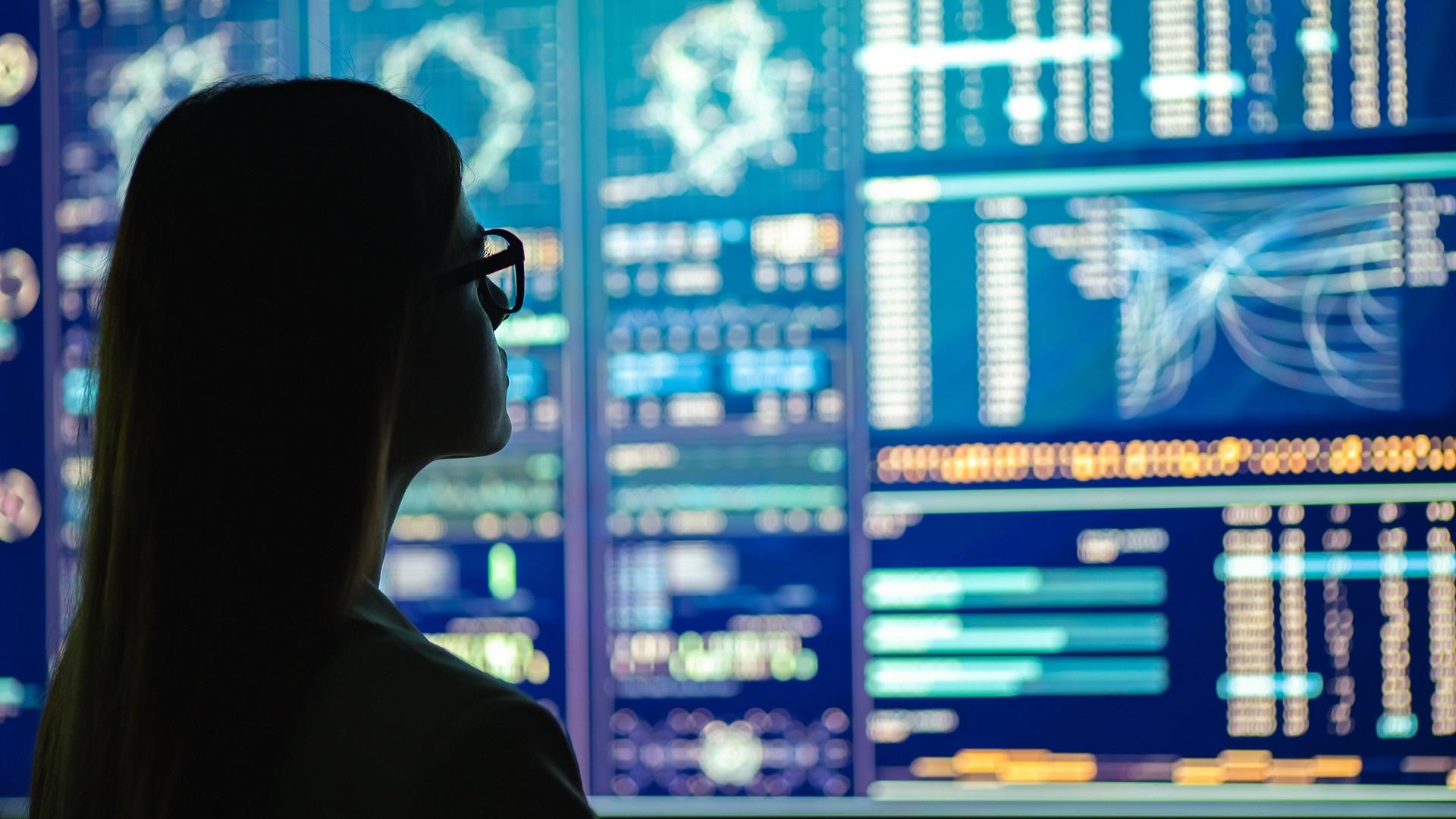 Woman reviewing data display.