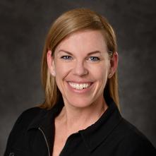 Headshot of woman wearing a black shirt